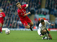 Fotball: Liverpool John Arne Riise and Bolton Wanderers Nicky Southall during the Premiership match at Anfield, London. Tuesday 1st January 2002.<br /><br />Foto: David Rawcliffe/Digitalsport