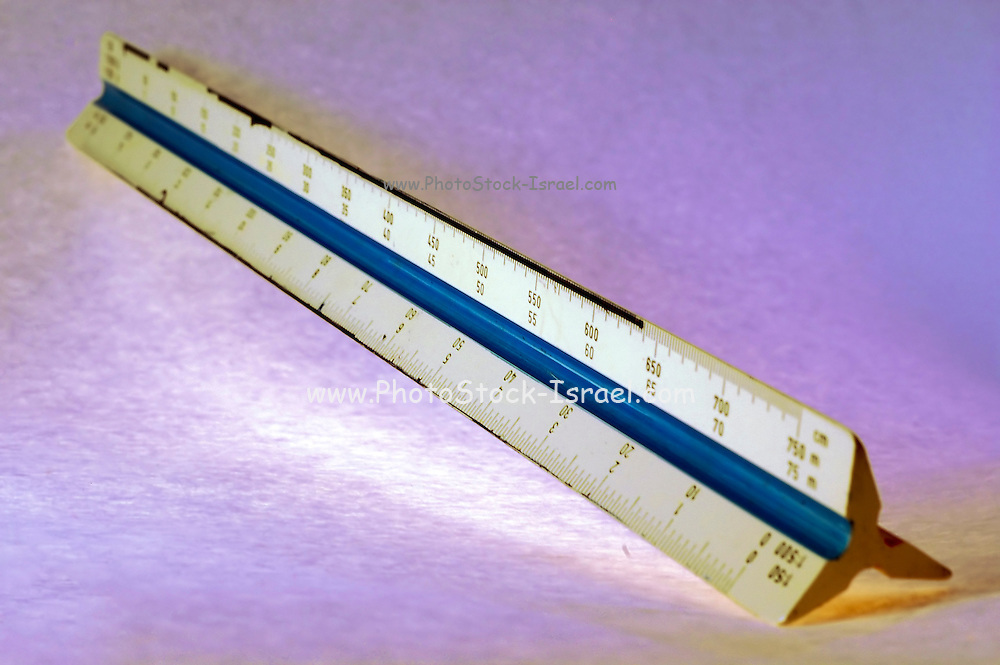 Selective focus Draftsman scale ruler on purple background