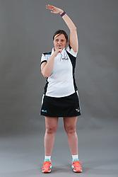 Umpire Rachael Radford signalling start/restart of play