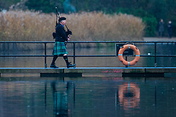 A piper leads swimmers onto the jetty before they take to the icy waters of the Serpentine in London's Hyde Park for the traditional Christmas Day Peter Pan Cup, a handicap race that sees the slowest swimmers starting first, cheered on by hundreds of spectators. London, December 25th 2018