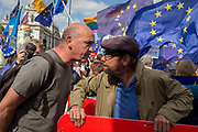 On the day that rebel Conservative Party rebels and opposition MPs attempt to pass a law designed to prevent a no-deal Brexit by the government of Prime Minister Boris Johnson, a pro-EU Remainer faces-off with a Brexiteer outside Parliament, on 3rd September 2019, in Westminster, London, England.