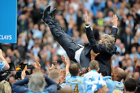Football - 2013 / 2014 Premier League - Manchester City vs. West Ham United<br /> Manuel Pellegrini Manager of Manchester City is thrown in the air by his team as they celebrate winning the Barclays Premier League at the Etihad Stadium, Manchester