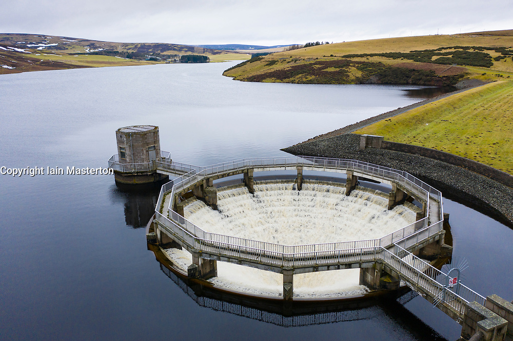 East Lothian, Scotland, UK. 20 Feb 2021. Meltwater from recent snow and heavy rain has filled Scottish reservoirs to capacity. Dam spillways are now full whilst discharging water downstream. Pic; Drone image of circular siphon spillway at Whiteadder Dam running at full capacity to discharge water from the reservoir. Iain Masterton/Alamy Live News