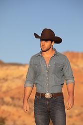 cowboy at sunset walking in the desert