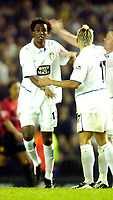 Photo. Jed Wee.<br /> Leeds United v Manchester United, Carling Cup, Elland Road, Leeds. 28/10/03.<br /> Leeds' slightly stunned Roque Junior (L) is congratulated by Alan Smith after he gives Leeds the lead.
