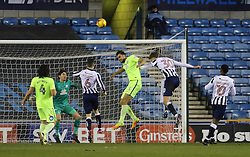 Ryan Tafazolli of Peterborough United heads clear while under pressure from Harry Smith of Millwall - Mandatory by-line: Joe Dent/JMP - 28/02/2017 - FOOTBALL - The Den - London, England - Millwall v Peterborough United - Sky Bet League One