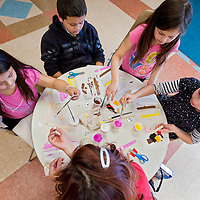 030713       Cable Hoover<br /> <br /> Haley Garcia, left, Andrew Martinez, Mikayla Martinez, Ashley Archuleta and their babysitter, Diane Tsethlikai make popsicle stick farm animals during crafts day at the Octavia Fellin Public Library Children's Branch in Gallup Thursday.
