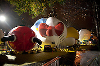 Macy's Thanksgiving Day Parade preparation on 81st Street the night prior to the parade. Balloons were blown up with huge tanks of helium and netted to the ground until morning...(Photo by Robert Caplin)..