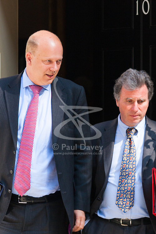 London, July 22nd 2014. Justice Minister Chris Grayling and Oliver Letwin, Minister for Government Policy, right, leave No.10 after the cabinet meeting at Downing Street.