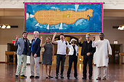 """Bono, second right, The Edge, center, of the Irish rock band U2, stand with Yoko Ono, widow of John Legend, third right, and Salil Shetty, Secretary General of Amnesty International, right, and others in front of a tapestry depicting the island of Manhattan as a yellow submarine piloted by a waving Lennon at Ellis Island Wednesday, July 29, 2015, in New York.<br /> <br /> A 24 foot-by-10 foot """"yelow submarine tapestry"""" honouring John Lennon, unveiled in front of Yoko Ono, Bono and The Edge at Ellis Island, New York, 29 July, 2015.<br /> The tapestry was commissioned by Art for Amnesty founder Bill Shipsey as a thank you to Ono for giving Amnesty International the rights to record cover versions of Lennon's post-Beatles songs.  <br /> Edu Bayer for Polaris"""