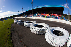 Central Park, the home ground of Cowdenbeath Football Club. It has the unusual feature of a motor racing track around the playing surface as the ground hosts regular stock car racing events.