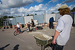 © Licensed to London News Pictures. 18/09/2011. Crays Hill, UK. Dale Farm residents  prepare for the eviction of  around 80 traveller families from the UK's largest illegal site,  which is due to start tomorrow (Mon). Barricades are being built to prevent entry to the site. Photo credit: Ben Cawthra/LNP