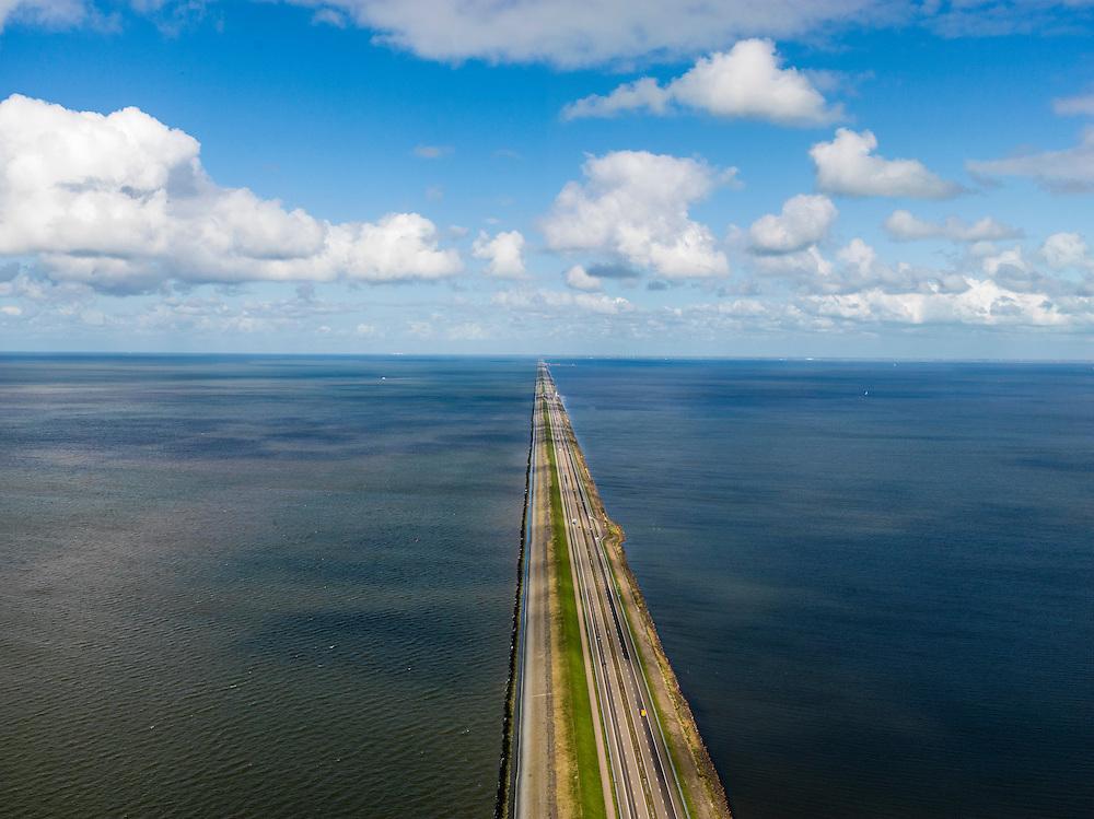 Nederland, Noord-Holland, Gemeente Wieringen, 16-04-2012; Den Oever, begin Afsluitdijk, gezien naar het noordoosten. Aan de horizon is de kust van Friesland zichtbaar. De 32 kilometer lange dijk vormt de waterkering tussen Waddenzee (links) en IJsselmeer (rechts). .Den Oever, beginning Enclosure Dam, looking east. Construction of the dam was part of the Zuiderzee Works, an initiative of engineer Cornelis Lely..luchtfoto (toeslag), aerial photo (additional fee required)..foto/photo Siebe Swart
