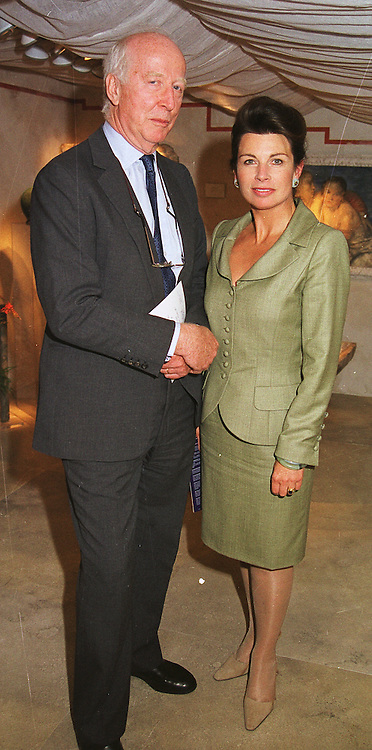 MR PETER & the HON.MRS STANLEY at an antiques fair in London on 9th June 1999.MSY 64