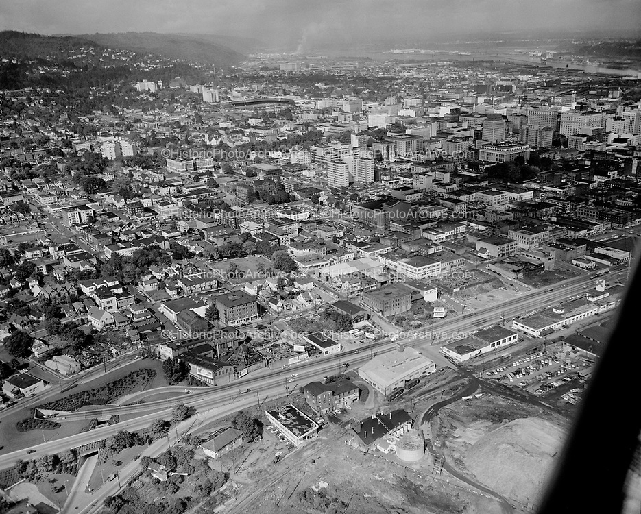 Y-551005-07. aerial of SW Portland South Auditorium Urban Renewal area looking west. Ross Island bridge ramps in foreground. October 5, 1955.