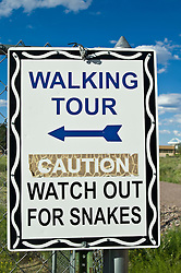 Sign to find the walking tour and to watch out for snakes in New Mexico