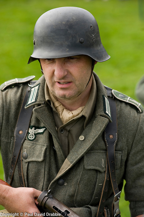 A reenactor portrays a German Panzergrenadier (GrossDeutschland Regiment) during a battle reanactment at the The first Annual Lytham 1940s Weekend held to celebrate the 70th anniversary of the battle of Britain and raise funds for a new Fighter and Bomber Command Memorial to be erected in Lytham. 21 August 2010 Images © Paul David Drabble.