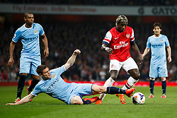Arsenal Defender Bacary Sagna (FRA) is challenged by Man City Midfielder James Milner (ENG) - Photo mandatory by-line: Rogan Thomson/JMP - 07966 386802 - 29/03/14 - SPORT - FOOTBALL - Emirates Stadium, London - Arsenal v Manchester City - Barclays Premier League.