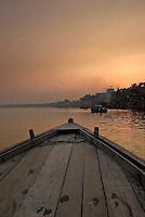 A tourist boat heading towards the Burning Ghat in Varanasi, Uttar Pradesh, India