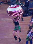 23.07.2014. Glasgow, Scotland. Glasgow Commonwealth Games. The opening ceremony. Dancer with a huge Tunnocks teacake