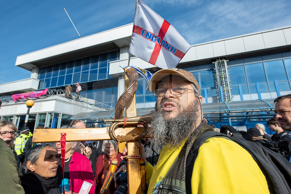 © Licensed to London News Pictures. 10/10/2019. London, UK. As Extinction Rebellion protesters attempt to block the main entrance to London City Airport a counter-protester confronts the protesters. Photo credit: Peter Manning/LNP
