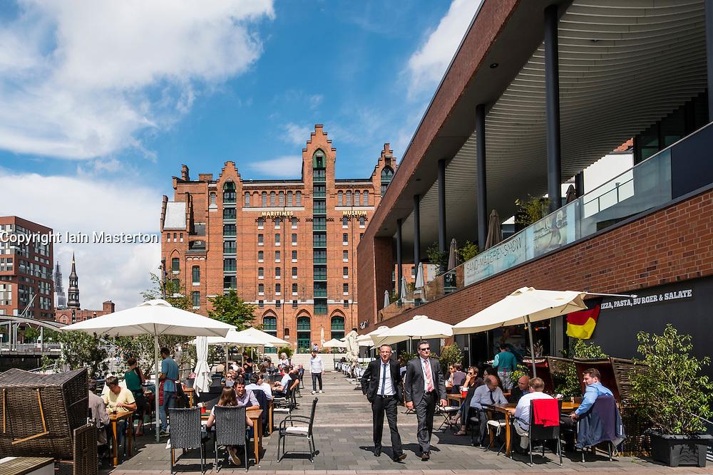 View of busy Elbtorpromenade and Elbarkaden new property developments in Hafencity Hamburg Germany