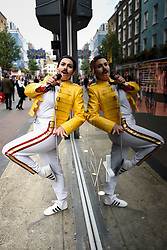 "© Licensed to London News Pictures. 05/09/2018. LONDON, UK.  Charlotte Quinn, a drag king and Queen fan from San Franscisco, strikes a pose in Carnaby Street during ""Freddie for a Day"", a fundraising event in aid of the Mercury Phoenix Trust on Freddie Mercury's birthday.  Queen tribute band ""Bulsara and the Queenies"" sang iconic songs entertaining crowds.  Photo credit: Stephen Chung/LNP"