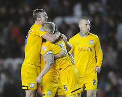 Preston North End's Tom Clarke celebrates with his team mates after the final whistle blows - Photo mandatory by-line: Dougie Allward/JMP - Mobile: 07966 386802 - 22/11/2014 - Sport - Football - Bristol - Ashton Gate - Bristol City v Preston North End - Sky Bet League One