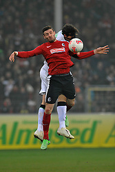30.03.2013, Mage Solar Stadion, Freiburg, GER, 1. FBL, SC Freiburg vs Borussia Moenchengladbach, 27. Runde, im Bild Kopfballduell zwischen (l.) Martin STRANZL (Borussia Moenchengladbach) (r.) Daniel CALIGIURI (SC Freiburg) // during the German Bundesliga 27th round match between SC Freiburg and Borussia Moenchengladbach at the Mage Solar Stadium, Freiburg, Germany on 2013/03/30. EXPA Pictures © 2013, PhotoCredit: EXPA/ Eibner/ Sven Laegler..***** ATTENTION - OUT OF GER *****