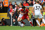 Mohamed Salah of Liverpool shields the ball from Ben Mee of Burnley. Premier League match, Liverpool v Burnley at the Anfield stadium in Liverpool, Merseyside on Saturday 16th September 2017.<br /> pic by Chris Stading, Andrew Orchard sports photography.