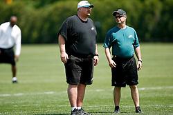 Philadelphia Eagles Head Coach Andy Reid and Head Athletic Trainer Rick Burkholder during the NFL Preseason Minicamp at the Novacare Complex in Philadelphia, Pennsylvania. (Photo By Brian Garfinkel)