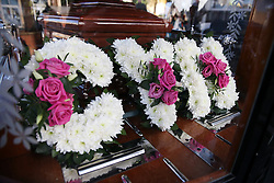© Licensed to London News Pictures. 09/12/2015. London, UK. Flowers spelling out the word CYN in the carriage carrying the coffin...  The funeral of former brothel keeper Cynthia Payne takes place at the South London Crematorium.  In 1980 Cynthia Payne was sentenced to 18 months for running a brothel at her house on Ambleside Avenue in Streatham. It was alleged, at the time, that judges and Members of Parliament were visitors to her establishment. Photo credit: Peter Macdiarmid/LNP
