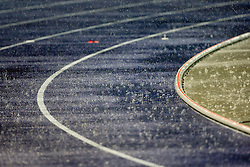 Rain pours down during the 2009 IAAF Athletics World Championships on August 21, 2009 in Berlin, Germany. (Photo by Vid Ponikvar / Sportida)