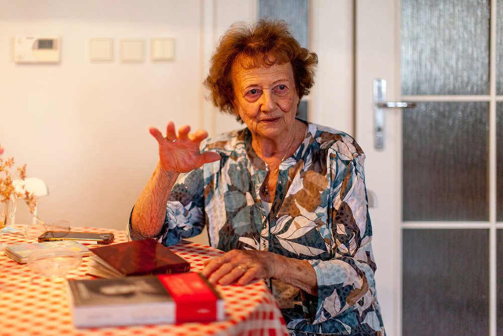 """Dita Kraus in front of the french edition of her book in her flat in Prague Vinohrady. Born in Prague to a Jewish family in 1929, Dita Kraus has lived through the most turbulent decades of the twentieth and early twenty-first centuries. Here, Dita writes in her book """"A Delayed Life: The true story of the Librarian of Auschwitz"""" with startling clarity on the horrors and joys of a life delayed by the Holocaust. From her earliest memories and childhood friendships in Prague before the war, to the Nazi-occupation that saw her and her family sent to the Jewish ghetto at Terezín, to the unimaginable fear and bravery of her imprisonment in Auschwitz and Bergen-Belsen, and life after liberation."""