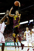 Guard Amir Coffey (5) goes up for a layup during the first half of the University of Minnesota Men's Basketball game versus University of Wisconsin on March 5, 2017.