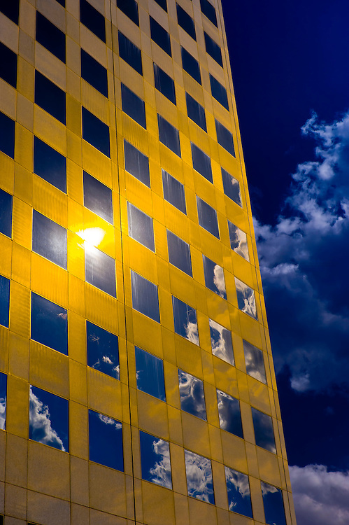Clouds reflecting into a gold colored building (The Republic Plaza Building), Downtown Denver, Colorado USA