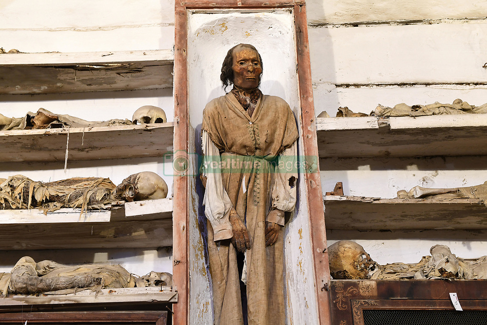 NO WEB FOR FRANCE - The Capuchin Catacombs of Palermo, Sicily, Italy on January 2019. The mummified body of Antonio Prestigiacomo ( d.1844) one of the best preserved. The catacombs contain about 8000 corpses and 1252 mummies. Palermo's Capuchin monastery outgrew its original cemetery in the 16th century and monks began to excavate crypts below it. In 1599 they mummified one of their number, recently dead brother Silvestro of Gubbio, and placed him into the catacombs. The cemetery was first reserved for ecclesiastical workers, then accepted deceased from all walks of life, and experienced its greatest popularity during the 19th century. An inscription hanging from the neck or pinned to the chest, indicates the name, birth and death dates of the deceased.The cemetary was officially closed by civil order in 1880. But the last burials are from the 1920s. The cemetary has now become a kind of museum, filled with the forgotten dead, who are watched over by a group of Capuchin monks. Sicily will reveal over time a real research laboratory on mummification. It is spreading throughout the island and there is not an important village in sight that does not display the bodies of their priests, monks or citizens in the crypt of their church. Photo by Eric Vandeville/ABACAPRESS.COM