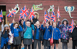 "© Licensed to London News Pictures. 17/12/2015. Wraxall, North Somerset, UK.  Local school children greet the Princess Royal, Princess Anne, who opened 'Elephant Eden' and elephant play zone at Noah's Ark Zoo Farm in Bristol. HRH The Princess Royal officially opened the 20 acre Elephant Eden habitat – the largest of its kind in northern Europe. Described as a ""five star hotel for elephants"" by international elephant management specialist Alan Roocroft, Elephant Eden saw the arrival of its first African elephant in 2014 and has had finishing touches to the complex completed this year along with the arrival of further elephants. Now home to two characterful bull elephants Janu and M'Changa, Elephant Eden has been celebrated as offering welfare improvements to the industry and has been used as a helpful model for other collections to base their own building plans on, including international zoo colleagues from as far afield as Japan.<br />  Noah's Ark will also unveil its new Elephant Play Zone for children next to the elephant barn, which will include an impressive 4m high scale model elephant with built-in slide.<br /> Photo credit : Simon Chapman/LNP"