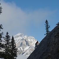 Barb Wilson climbs a face at Rundle Rock, below Cascade Mountain, near Banff, Alberta, in Canada's Banff National Park.