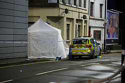 A white police tent covers the body of yet another victim of knife crime in the capita, this time in Morning Lane, Hackney. London, April 04 2018.