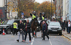 Police presence before the Premier League match at the Emirates Stadium, London.