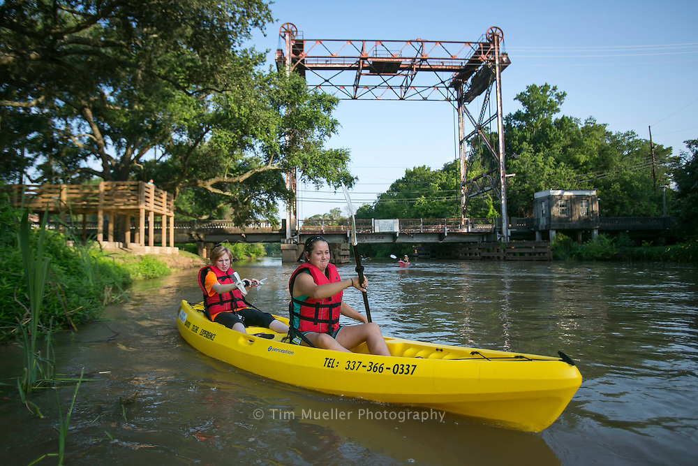 Lexi LeGrand, front, and M. Nicole Patin paddle Bayou Tech near Breaux Bridge, La. with kayaks from Bayou Teche Experience. Bayou Tech Experience offers kayak and bike rentals to explore the Cajun country bayous, lakes, and swamps of south Louisiana.
