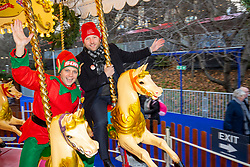 The Scottish Elf Minister interviewing Labour's Ian Murray on a carousel at Edinburgh's Christmas Market.