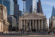 City of London England UK March 2021<br />Deserted City of London during the Covid 19 Lockdown in 2021<br />The Bank Junction showing the Bank of England on the left and Royal Exchange in the centre and 22 Bishopsgate towering abov, on the right is 1 Cornhill. 22 Bishopsgate, also known as Twentytwo, is a commercial skyscraper in London, United Kingdom. Completed in 2020 it occupies a prominent site in Bishopsgate, in the City of London financial district, and stands at 278 m (912 ft) tall with 62 storeys. The project replaces an earlier plan for a 288 m (945 ft) tower named The Pinnacle, on which construction was started in 2008 but suspended in 2012 following the Great Recession, with only the concrete core of the first seven storeys. The structure was later subjected to a re-design, out of which it became known by its postal address, 22 Bishopsgate