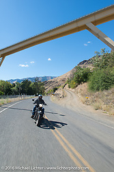 Motorcycle Cannonball organizer Lonnie Isam Jr riding his 1934 Harley-Davidson VL during stage 14 - (284 miles) of the Motorcycle Cannonball Cross-Country Endurance Run, which on this day ran from Meridian to Lewiston, Idaho, USA. Friday, September 19, 2014.  Photography ©2014 Michael Lichter.