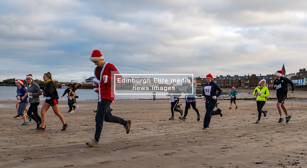 North Berwick, East Lothian, Scotland, United Kingdom. The annual Santa Run takes place with socially distanced households running together at staggered intervals, rather than the usual mass start. The event raises money each year for a charity, which this year is 'Just Wheels' www.justwheels.org.uk, a Scottish charity supporting people with physical disabilities in Tanzania by providing wheelchairs and training. The money raised is enough to buy 4 wheelchairs. <br /> Sally Anderson   EdinburghElitemedia.co.uk