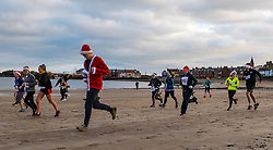 North Berwick, East Lothian, Scotland, United Kingdom. The annual Santa Run takes place with socially distanced households running together at staggered intervals, rather than the usual mass start. The event raises money each year for a charity, which this year is 'Just Wheels' www.justwheels.org.uk, a Scottish charity supporting people with physical disabilities in Tanzania by providing wheelchairs and training. The money raised is enough to buy 4 wheelchairs. <br /> Sally Anderson | EdinburghElitemedia.co.uk