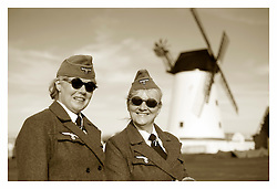 Lytham Saint Annes Saturday 18th August..Pictured beside Lytham Windmill two female members of the Northern World War 2 Association (NWW2A) portray Nachrichtenhelferin des Heeres,  Signals Auxiliaries with the German Amy ..18 August 2012.Image © Paul David Drabble