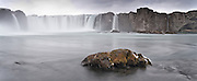 Three images stitched together of Godafoss waterfall.