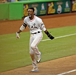 June 19, 2017 - Miami, FL, USA - Miami Marlins' Dee Gordon runs home to score the winning run in the bottom of the ninth inning off a Marcell Ozuna RBI against the Washington Nationals on Monday, June 19, 2017 in Miami, Fla. (Credit Image: © Patrick Farrell/TNS via ZUMA Wire)